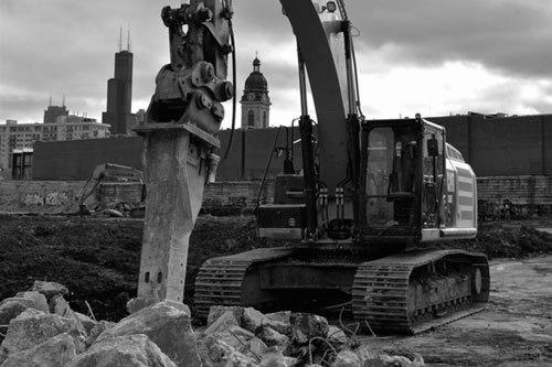 chicago area demolition project, with chicago skyline in background